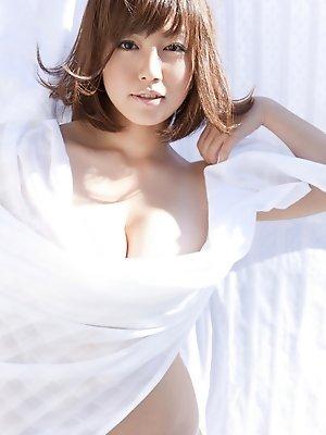 Sayaka Isoyama Asian hides big boobs under sheets in the garden