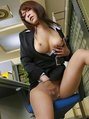 Sakura Kokomi Asian with specs arouses her big tits and shows ass