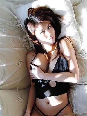 Delectable asian beauty seduces in her skimpy little bikini