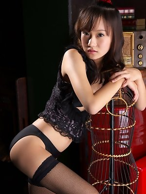 Beautiful gravure idol babe dressed in black lace lingerie