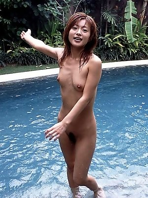 Adorable Asian model likes being naked and showing her tits and hot pussy