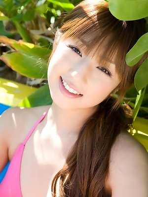 Energetic asian beauty is ready to tee off in her cute outfit
