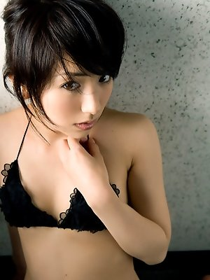 Short haired asian chick showing off her tight bottom in lingerie