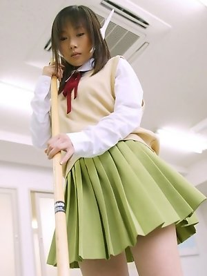 Asian slut dresses the part of a school girl and cleans up the class room